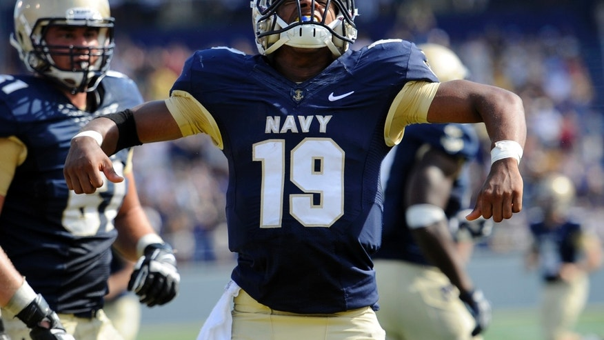 FILE - In this Oct. 5, 2013 file photo, Navy quarterback Keenan Reynolds celebrates after scoring a touchdown during an NCAA football game against Air Force in Annapolis, Md. Reynolds has enjoyed a sensational sophomore season, running for 1,124 yards and 26 touchdowns. Perhaps the only way it can get better is if he can lead the Midshipmen to their 12th straight win over Army this Saturday in Philadelphia. (AP Photo/Nick Wass, File)