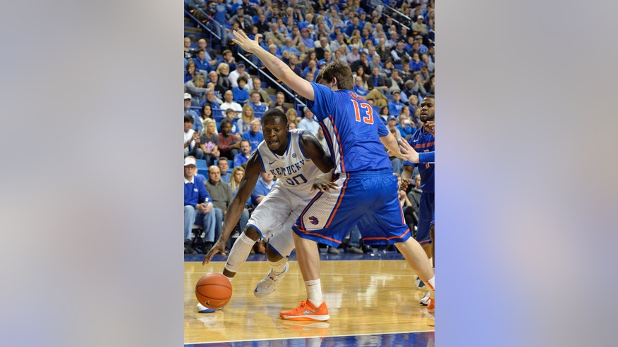 Kentucky's Julius Randle, left, attempts to drive under the defense of Boise State's Nick Duncan during the second half of an NCAA college basketball game Tuesday Dec. 10, 2013, in Lexington, Ky. Kentucky defeated Boise State 70-55. (AP Photo/Timothy D. Easley)