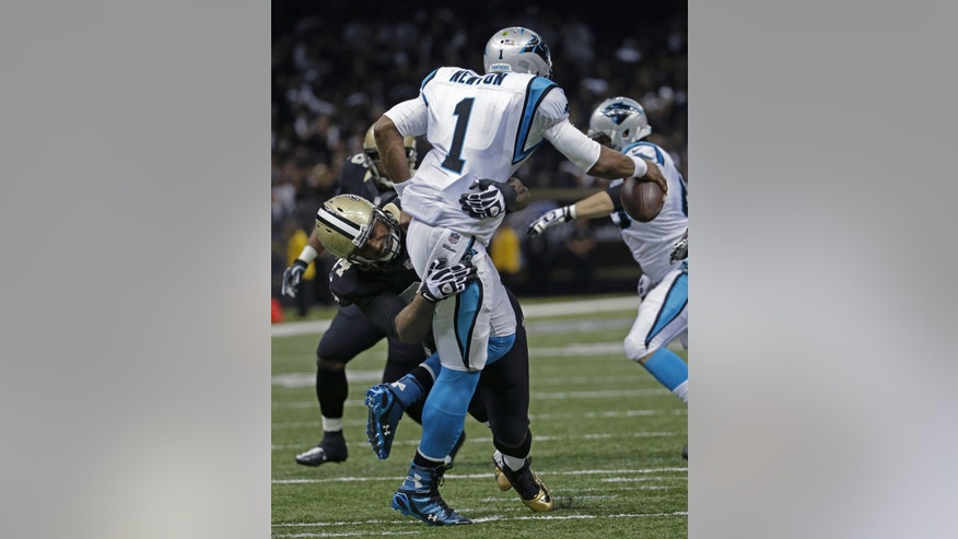 Carolina Panthers quarterback Cam Newton (1) is sacked by New Orleans Saints defensive end Cameron Jordan (94) in the first half of an NFL football game in New Orleans, Sunday, Dec. 8, 2013. (AP Photo/Dave Martin)