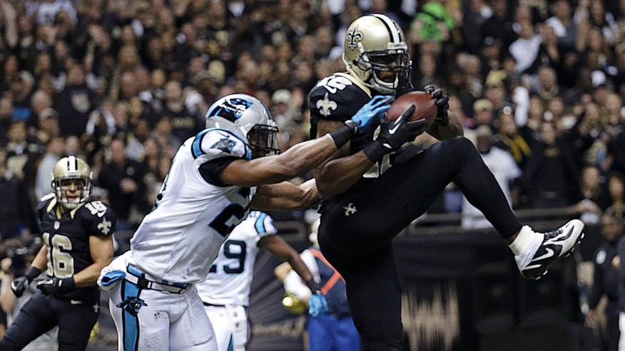 New Orleans Saints wide receiver Marques Colston (12) pulls in a touchdown reception over Carolina Panthers free safety Mike Mitchell (21) in the first half of an NFL football game in New Orleans, Sunday, Dec. 8, 2013.  (AP Photo/Dave Martin)