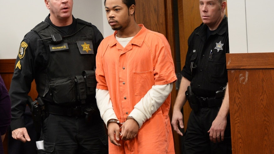 Kristopher Pratt, 20, of Detroit, a suspect in the shooting death of Eastern Michigan football player Demarius Reed, walks into the courtroom before a preliminary examination at district court in Pittsfield Township, Mich., on Thursday, Dec. 5, 2013.  The hearing was adjourned until January, 2014.(AP Photo/AnnArbor.com, Melanie Maxwell) LOCAL TV OUT; LOCAL INTERNET OUT