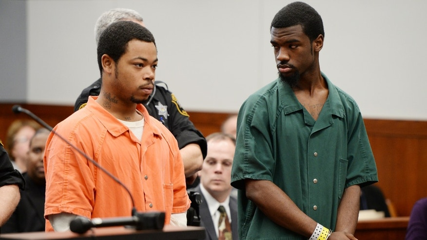 From left, Kristopher Pratt, 20, of Detroit, and Ed Jones, 20, of Detroit, both suspects in the shooting death of Eastern Michigan football player Demarius Reed stand during a preliminary examination at district court in Pittsfield Township, Mich., on Thursday, Dec. 5, 2013. The hearing was adjourned until January, 2014.  (AP Photo/AnnArbor.com, Melanie Maxwell) LOCAL TV OUT; LOCAL INTERNET OUT