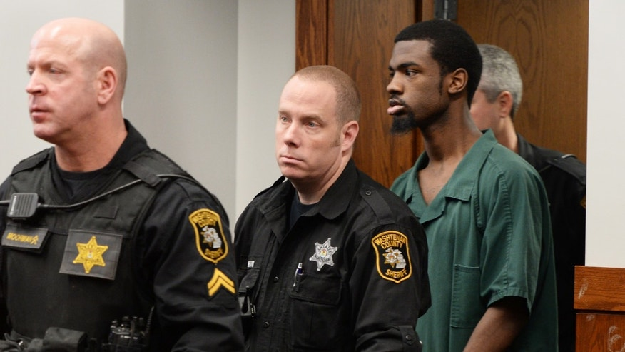Ed Thomas, 20, of Detroit, a suspect in the shooting death of Eastern Michigan football player Demarius Reed, walks into the courtroom before a preliminary examination at district court in Pittsfield Township, Mich., on Thursday, Dec. 5, 2013. The hearing was adjourned until January, 2014. Thomas, one of two suspects, faces first-degree murder and robbery charges in the Oct. 18 killing of Reed.  (AP Photo/AnnArbor.com, Melanie Maxwell) LOCAL TV OUT; LOCAL INTERNET OUT