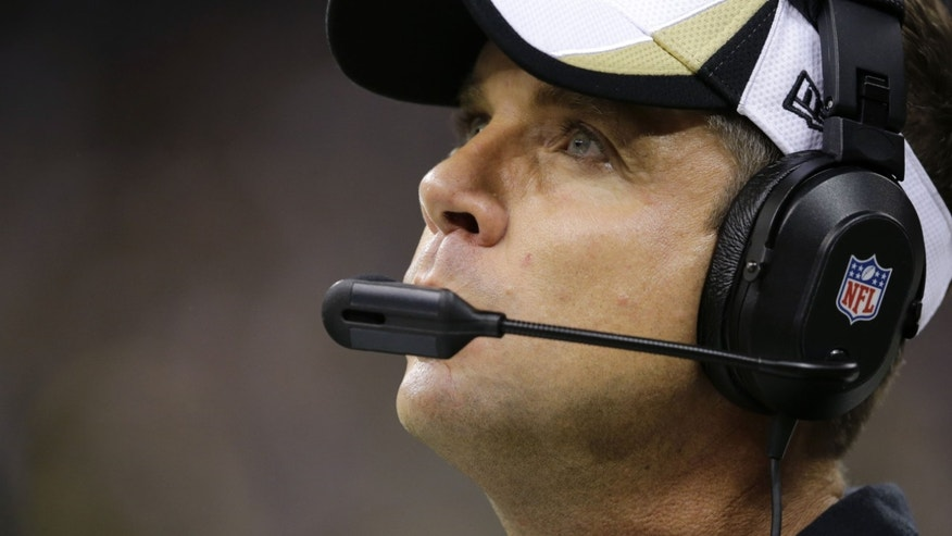 New Orleans Saints head coach Sean Payton watches from the sideline in the second half of an NFL football game against the Carolina Panthers in New Orleans, Sunday, Dec. 8, 2013. (AP Photo/Bill Haber)