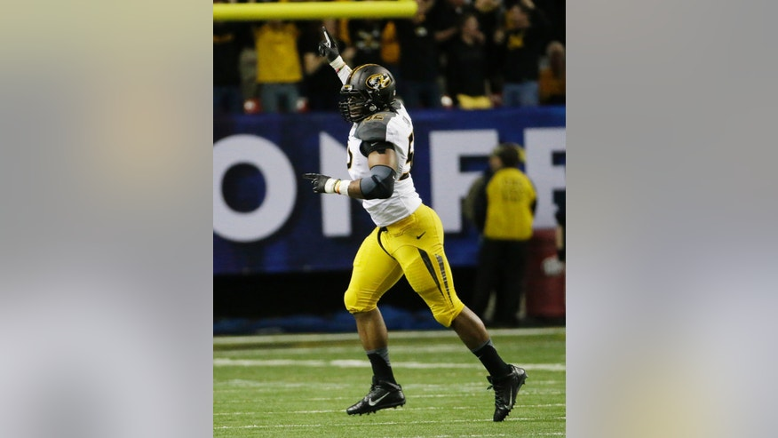 Missouri defensive lineman Michael Sam (52) reacts after Auburn fumbled and Missouri recovered during the first half of the Southeastern Conference NCAA football championship game, Saturday, Dec. 7, 2013, in Atlanta. (AP Photo/David Goldman)