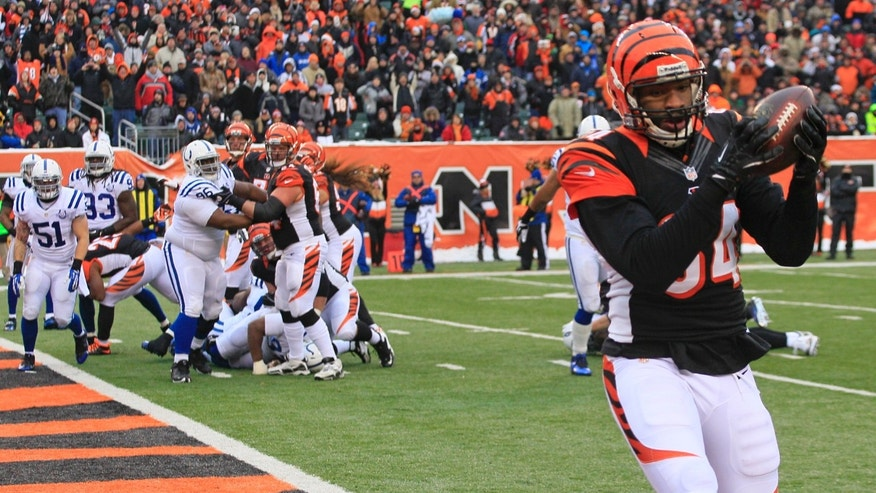 Cincinnati Bengals tight end Jermaine Gresham (84) catches a 1-yard touchdown pass against the Indianapolis Colts in the second half of an NFL football game, Sunday, Dec. 8, 2013, in Cincinnati. (AP Photo/Tom Uhlman)