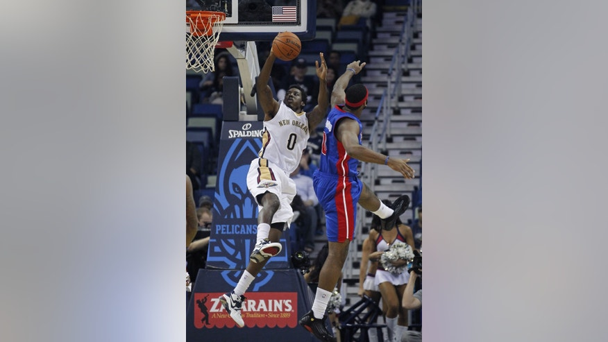 New Orleans Pelicans small forward Al-Farouq Aminu (0) drives to the basket past Detroit Pistons center Andre Drummond in the first half of an NBA basketball game in New Orleans, Wednesday, Dec. 11, 2013. (AP Photo/Gerald Herbert)