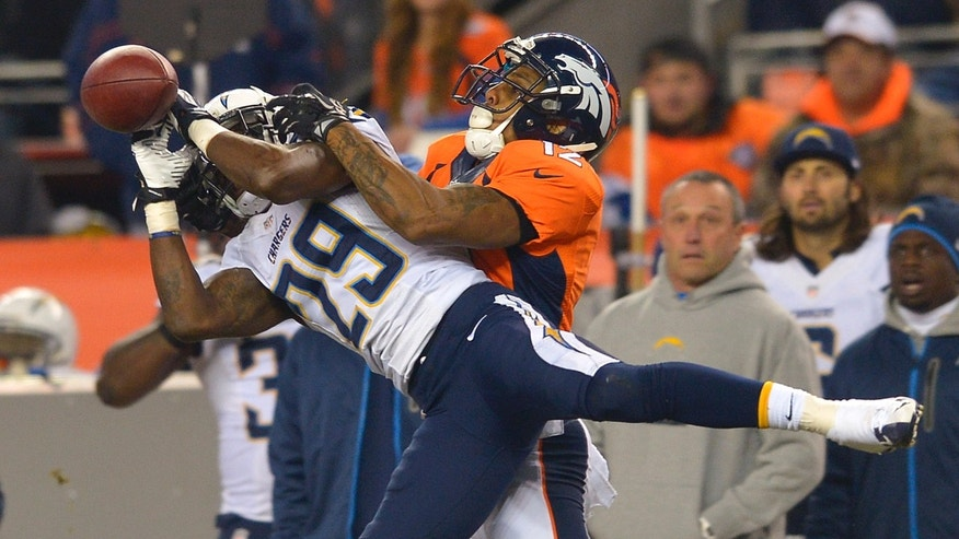 San Diego Chargers cornerback Shareece Wright (29) breaks up a pass intended for Denver Broncos wide receiver Andre Caldwell (12) in the second quarter of an NFL football game, Thursday, Dec. 12, 2013, in Denver. (AP Photo/Jack Dempsey)