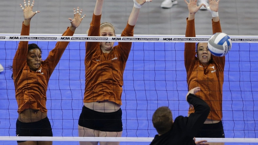 Texas' Chloe Collins, left, Sara Hattis, center, and Amy Neal go up for a block during practice in Lincoln, Neb., Thursday, Dec. 12, 2013. Texas plays American on Friday in the NCAA college volleyball Lincoln regional. (AP Photo/Nati Harnik)
