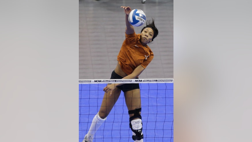 Texas' Khat Bell hits the ball over the net during practice in Lincoln, Neb., Thursday, Dec. 12, 2013. Texas plays American on Friday in the NCAA college volleyball Lincoln regional. (AP Photo/Nati Harnik)