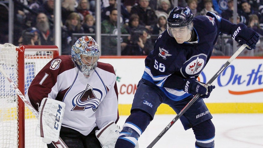 Winnipeg Jets' Mark Scheifele (55) attempts to deflect the shot past Colorado Avalanche's goaltender Semyon Varlamov (1) during second period NHL action in Winnipeg on Thursday, December 12, 2013. THE CANADIAN PRESS/John Woods