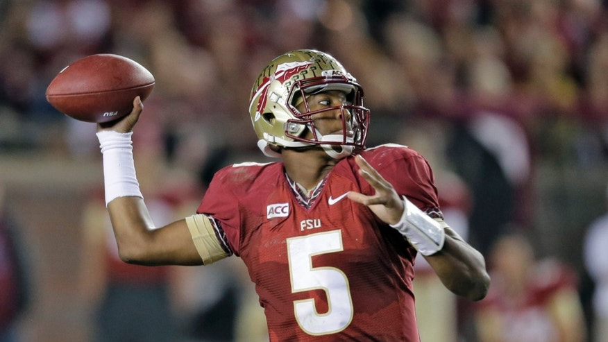FILE - In this Nov. 2, 2013 file photo, Florida State quarterback Jameis Winston throws a pass during the third quarter of an NCAA college football game against Miami, in Tallahassee, Fla. (AP Photo/Chris O'Meara, File)