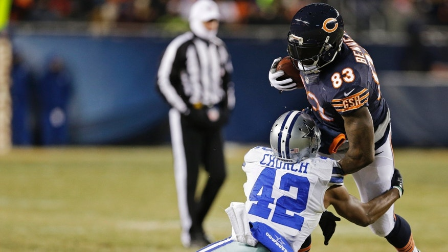 Dallas Cowboys safety Barry Church (42) tackles Chicago Bears tight end Martellus Bennett (83) during the first half of an NFL football game, Monday, Dec. 9, 2013, in Chicago. (AP Photo/Nam Y. Huh)