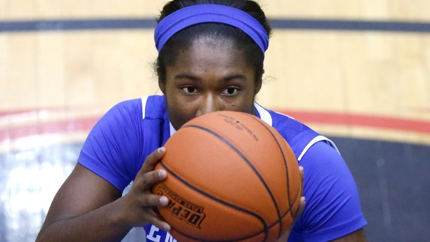 Kentucky guard Linnae Harper eyes a free throw during the second half of an NCAA college basketball game against DePaul Thursday, Dec. 12, 2013, in Chicago. Kentucky won 96-85. (AP Photo/Charles Rex Arbogast)