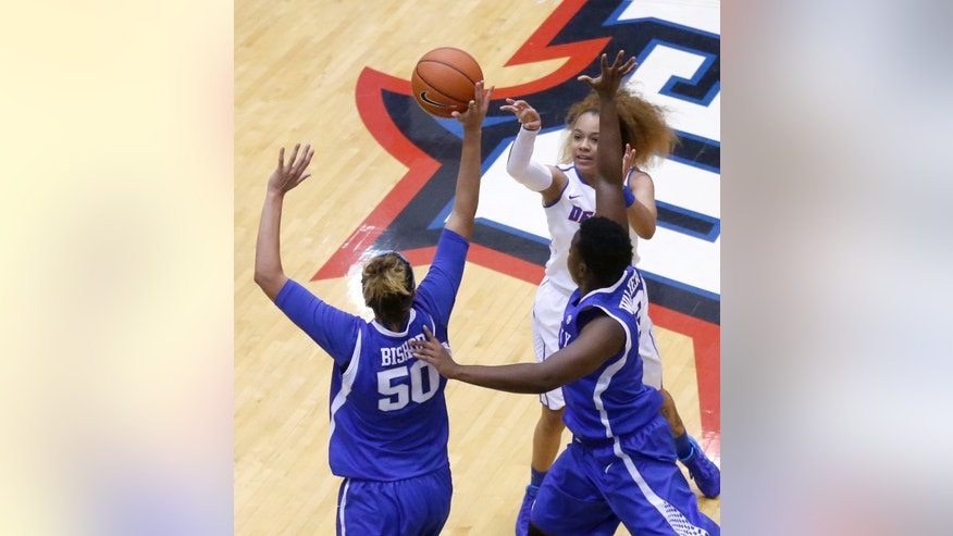 Kentucky forward/center Azia Bishop (50) blocks the shot of DePaul guard Brittany Hrynko as Samarie Walker also defends during the first half of an NCAA college basketball game on Thursday, Dec. 12, 2013, in Chicago, Ill. (AP Photo/Charles Rex Arbogast)