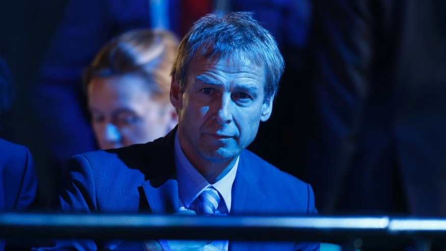 United States head coach Juergen Klinsmann from Germany waits for the beginning of the draw ceremony for the 2014 soccer World Cup in Costa do Sauipe near Salvador, Brazil, Friday, Dec. 6, 2013. (AP Photo/Victor R. Caivano)