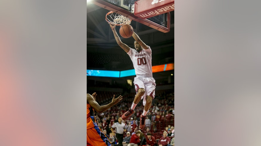 Arkansas guard Rashad Madden, (00), dunks the ball during the first half of a NCAA college basketball game against Savannah State, Thursday, Dec. 12, 2013 at Bud Walton Arena in Fayetteville, Ark. (AP Photo/Gareth Patterson)
