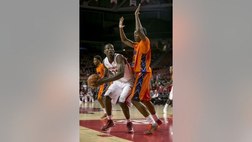 Arkansas center Moses Kingsley, left, looks to shoot against Savannah State forward Saadiq Muhammad, right, during the first half of a NCAA college basketball game at Bud Walton Arena in Fayetteville, Ark. (AP Photo/Gareth Patterson)