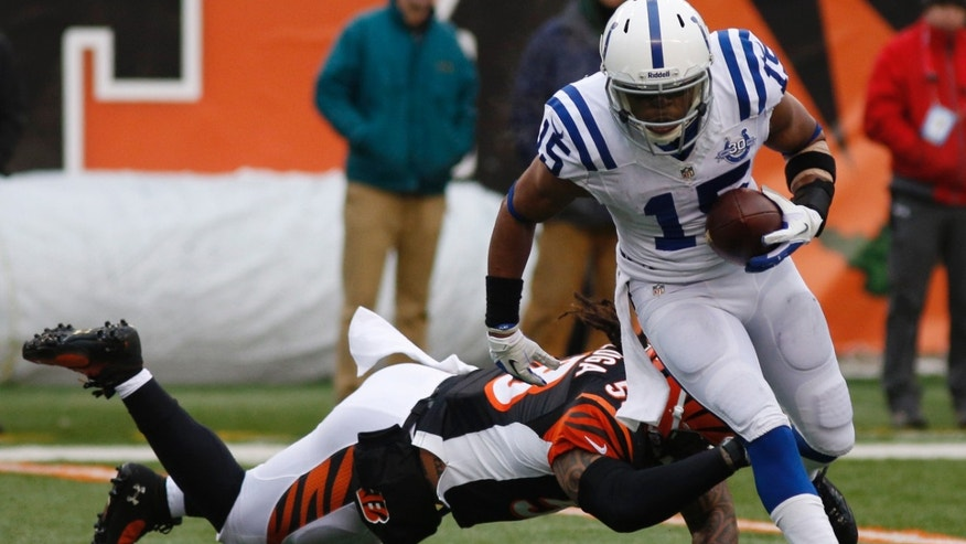Indianapolis Colts wide receiver LaVon Brazill (15) avoids a tackle by Cincinnati Bengals middle linebacker Rey Maualuga on his way to a 19-yard touchdown after catching a pass in the second half of an NFL football game, Sunday, Dec. 8, 2013, in Cincinnati. (AP Photo/David Kohl)