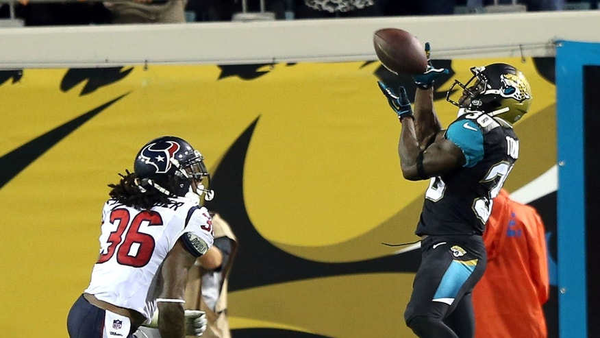 12/5/13 - Jags RB Jordan Todman (30) gathers in a pass from Ace Sanders for a TD at 6:12 in the 3rd quarter for the Jaguars to take a 24-10 lead. The Jacksonville Jaguars played a Thursday night game on Dec. 5, 2013 against the Houston Texans on EverBank Field in Jacksonville, FL.   (AP Photo/The Florida Times-Union,Gary McCullough)