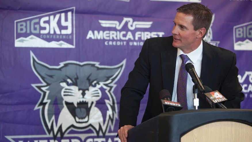 Jay Hill speaks with reporters at a press conference where he was introduced as the new head NCAA college football coach at Weber State University, Thursday, Dec. 12, 2013 in Ogden, Utah. (AP Photo/Standard-Examiner, Benjamin Zack) TV OUT; MANDATORY CREDIT
