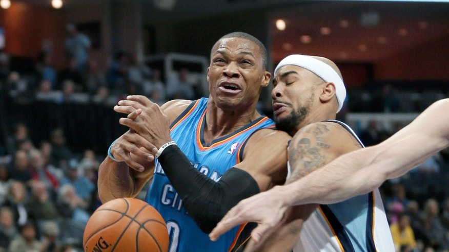 Oklahoma City Thunder's Russell Westbrook (0) is fouled by Memphis Grizzlies' Jerryd Bayless, right, in the first half of an NBA basketball game in Memphis, Tenn., Wednesday, Dec. 11, 2013. (AP Photo/Danny Johnston)