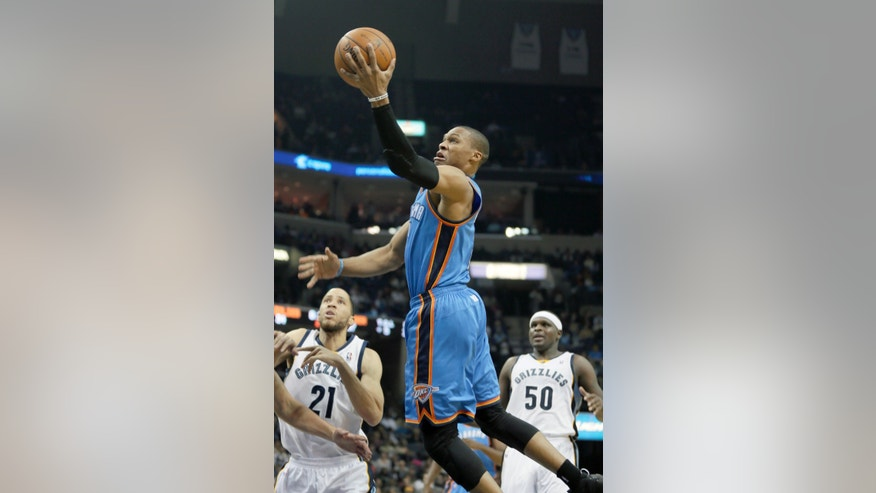 Oklahoma City Thunder's Russell Westbrook, center, goes to the basket as Memphis Grizzlies' Zach Randolph (50), and Tayshaun Prince (21) watch in the first half of an NBA basketball game in Memphis, Tenn., Wednesday, Dec. 11, 2013. (AP Photo/Danny Johnston)