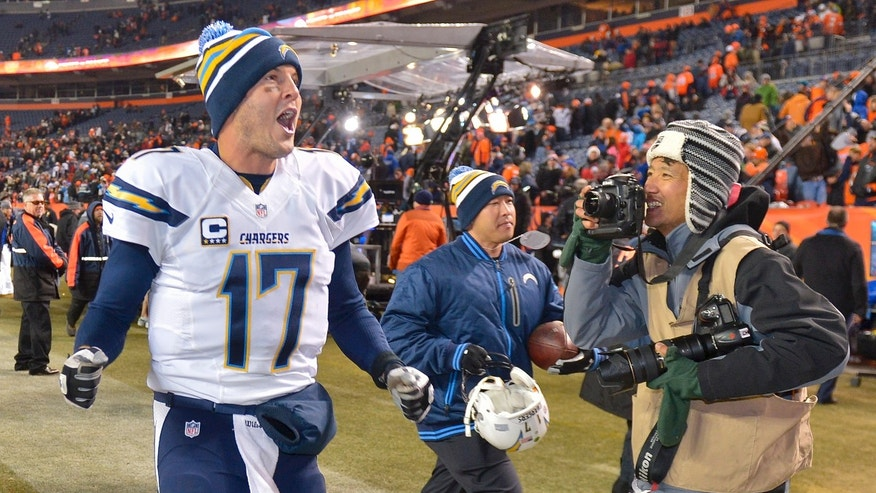 San Diego Chargers quarterback Philip Rivers (17) shouts to fans as he runs off the field after beating the Denver Broncos 27-20 in an NFL football game, Thursday, Dec. 12, 2013, in Denver. (AP Photo/Jack Dempsey)
