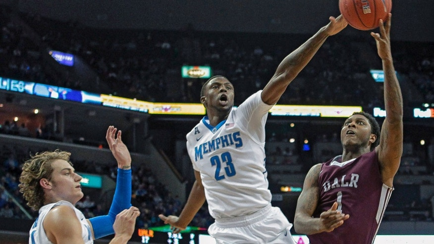 Memphis forwards Kuran Iverson (23) and Austin Nichols, left, try to stop Arkansas-Little Rock guard Leroy Isler (1) n the first half of an NCAA college basketball game on Friday, Dec. 13, 2013, in Memphis, Tenn. (AP Photo/Lance Murphey)