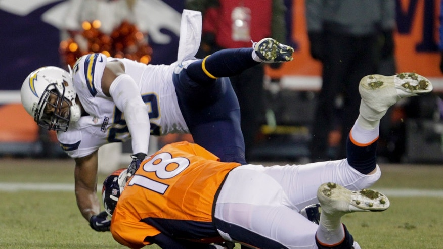 San Diego Chargers strong safety Marcus Gilchrist (38) sacks Denver Broncos quarterback Peyton Manning (18) in the second quarter of an NFL football game, Thursday, Dec. 12, 2013, in Denver. (AP Photo/Joe Mahoney)