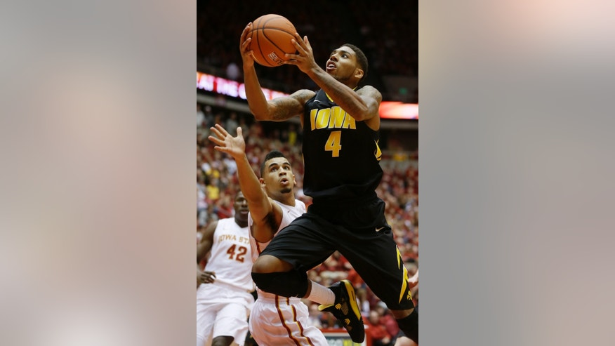 Iowa guard Devyn Marble, right, drives to the basket past Iowa State guard Naz Long during the first half of an NCAA college basketball game on Friday, Dec. 13, 2013, in Ames, Iowa. (AP Photo/Charlie Neibergall)
