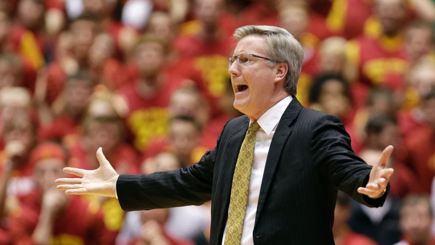 Iowa head coach Fran McCaffery reacts to a call against his team during the first half of an NCAA college basketball game against Iowa State, Friday, Dec. 13, 2013, in Ames, Iowa. (AP Photo/Charlie Neibergall)