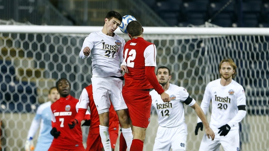 Notre Dame's Patrick Hodan (27) battles New Mexico's Kyle Venter (12) for a header in the second half during a semifinal match in theNCAA Division 1 men's soccer championships in Chester, Pa., Friday, Dec. 13, 2013. Notre Dame defeated New Mexico 2-0 to advance to Sunday's championship game. (AP Photo/Rich Schultz)