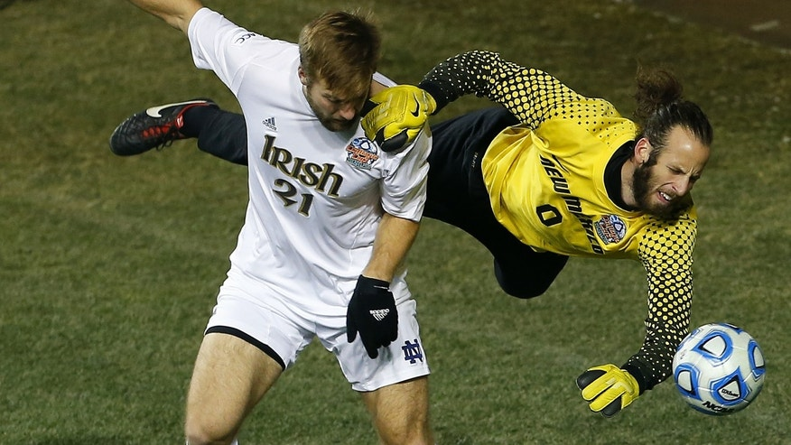 Notre Dame's Vince Cicciarelli (21) collides with New Mexico goalkeeper Michael Lisch (0) in the second half during a semifinal match in the  NCAA Division 1 men's soccer championships in Chester, Pa., Friday, Dec. 13, 2013. Notre Dame defeated New Mexico 2-0 to advance to Sunday's championship game. (AP Photo/Rich Schultz)