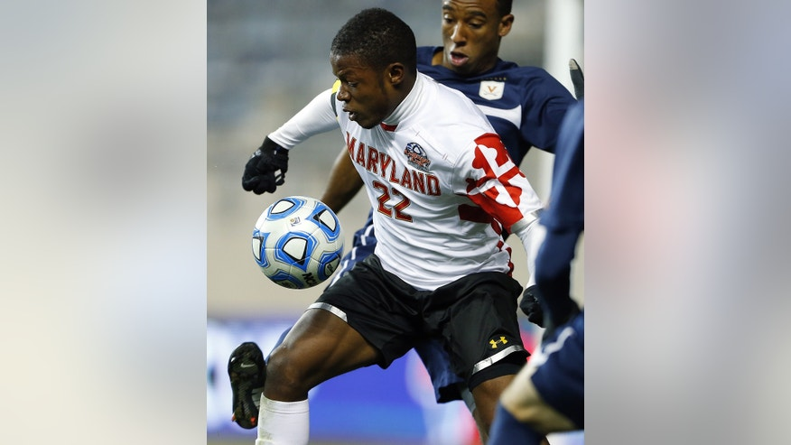 Maryland's Suli Dainkeh (22) keeps the ball from Virginia's Marcus Salandy-Defour in the first half during a semifinal match in the NCAA Division 1 men's soccer championships at PPL Park in Chester, Pa., Friday, Dec. 13, 2013. (AP Photo/Rich Schultz)