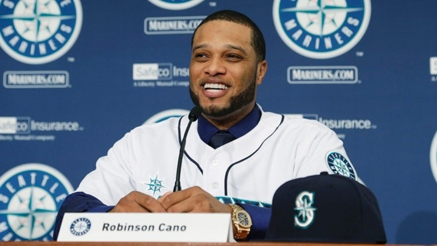 Dec. 12, 2013: Robinson Cano talks to reporters after he was introduced as the newest member of the Seattle Mariners baseball team in Seattle. (AP/Ted S. Warren)