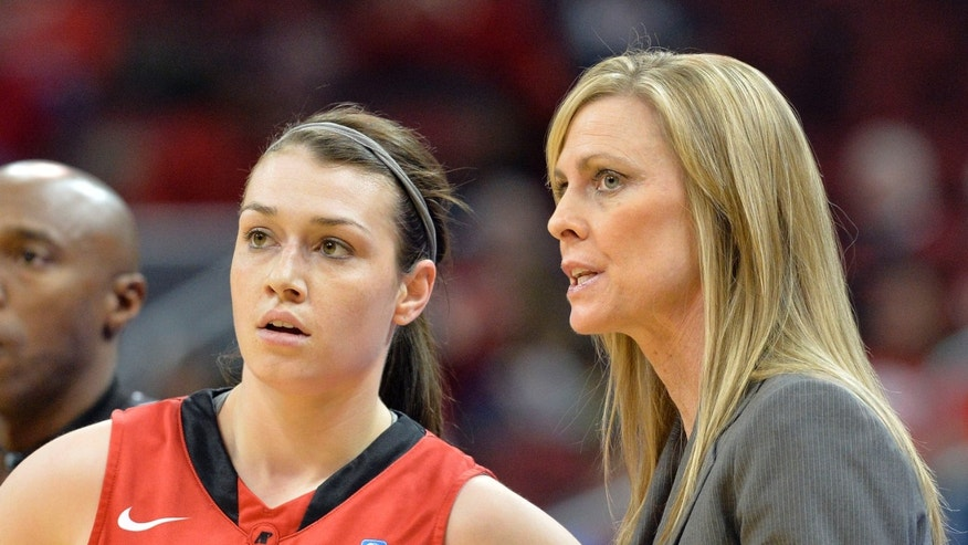 Austin Peay head coach Carrie Daniels talks with Kristen Stainback during the first half of an NCAA college basketball game against Louisville Saturday Dec. 14, 2013, in Louisville, Ky. (AP Photo/Timothy D. Easley)
