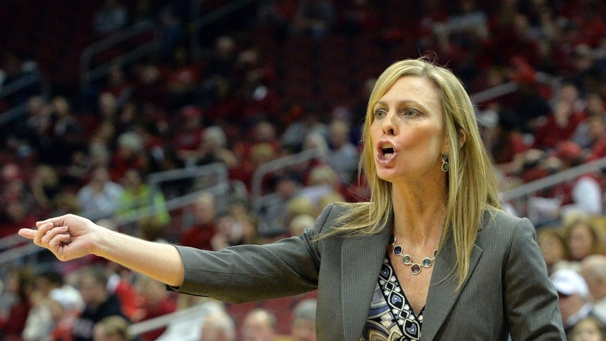 Austin Peay head coach Carrie Daniels shouts instructions to her team during the first half of an NCAA college basketball game against Louisville Saturday Dec. 14, 2013, in Louisville, Ky. Louisville defeated Austin Peay 108-53. (AP Photo/Timothy D. Easley)