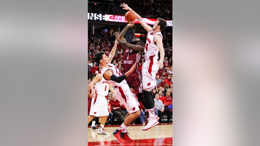Wisconsin's Duje Dukan, left, and Frank Kaminsky (44) defend against Eastern Kentucky's Glenn Cosey during the first half of an NCAA college basketball game Saturday, Dec. 14, 2013, in Madison, Wis. (AP Photo/Andy Manis)
