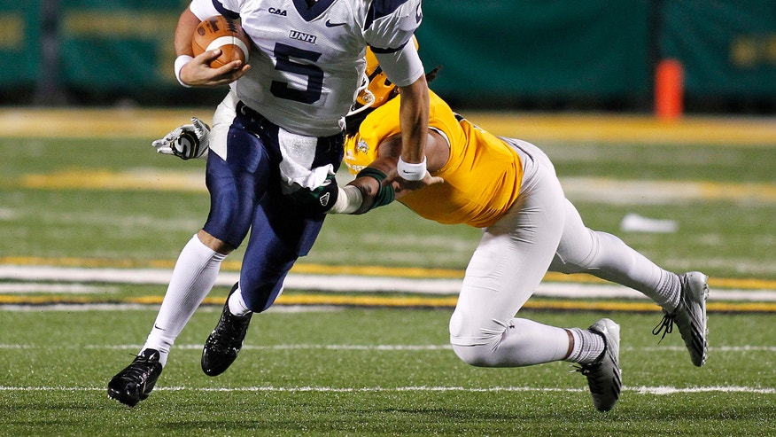 New Hampshire quarterback Sean Goldrich (5) runs past a Southeastern Louisiana defender during the first half of an NCAA college football Division 1 championship quarterfinal game in Hammond, La., Saturday, Dec. 14, 2013. (AP Photo/Jonathan Bachman)