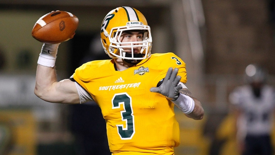 Southeastern Louisiana quarterback Bryan Bennett (3) throws the ball during the first half of an NCAA college football Division 1 championship quarterfinal game against New Hampshire in Hammond, La., Saturday, Dec. 14, 2013. (AP Photo/Jonathan Bachman)