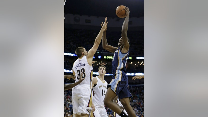Memphis Grizzlies power forward Ed Davis (32) shoots over New Orleans Pelicans power forward Ryan Anderson (33) in the first half of an NBA basketball game in New Orleans, Friday, Dec. 13, 2013. (AP Photo/Gerald Herbert)