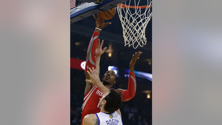 Houston Rockets' Dwight Howard, back, shoots over Golden State Warriors' Andrew Bogut during the first half of an NBA basketball game Friday, Dec. 13, 2013, in Oakland, Calif. (AP Photo/Ben Margot)