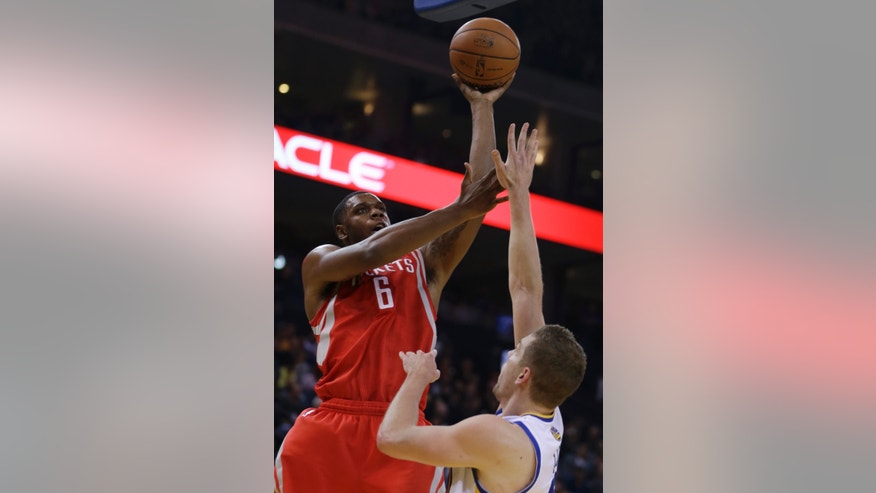 Houston Rockets' Terrence Jones (6) shoots over Golden State Warriors' David Lee during the first half of an NBA basketball game Friday, Dec. 13, 2013, in Oakland, Calif. (AP Photo/Ben Margot)