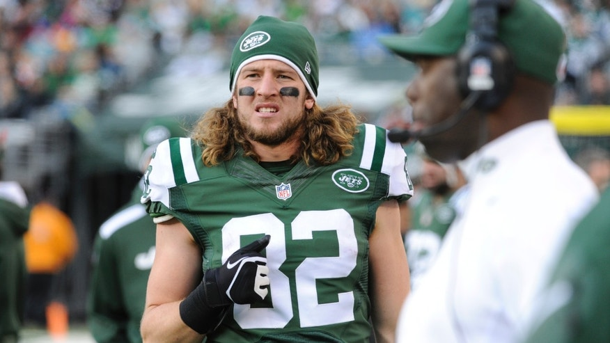ADVANCE FOR WEEKEND EDITIONS, DEC. 14-15 - FILE - In this Dec. 1, 2013 file photo, New York Jets tight end Zach Sudfeld (82) walks on the sideline during the second half of an NFL football game against the Miami Dolphins, in East Rutherford, N.J. Inspired by his experiences with his family helping orphaned children in underprivileged countries, a determined Sudfeld came back for a sixth year at Nevada, had a breakthrough season, and after a few more bumps in the road, is playing with the New York Jets as a backup. (AP Photo/Bill Kostroun, File)