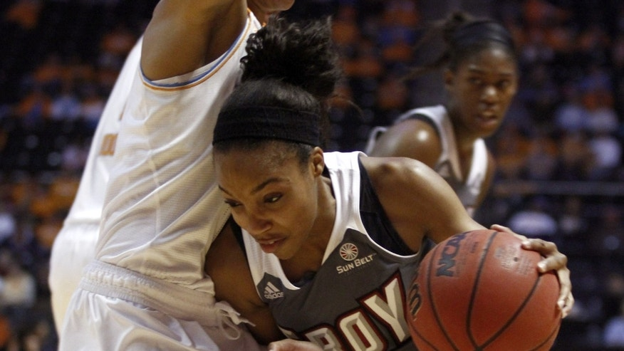 Troy guard Ashley Beverly-Kelley (4) drives against Tennessee forward Cierra Burdick (11) in the first half of an NCAA college basketball game on Saturday, Dec. 14, 2013, in Knoxville, Tenn. (AP Photo/Wade Payne)