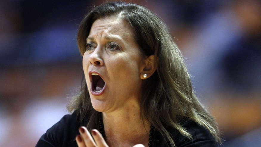 Troy head coach Chanda Rigby yells to her players in the first half of an NCAA college basketball game against Tennessee on Saturday, Dec. 14, 2013, in Knoxville, Tenn. (AP Photo/Wade Payne)