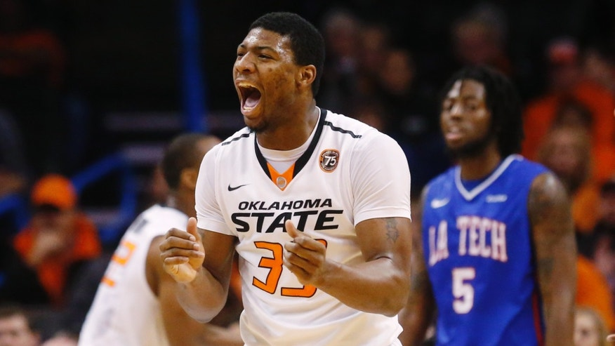Oklahoma State guard Marcus Smart (33) celebrates in the first half of an NCAA college basketball game against Louisiana Tech in the All College Classic in Oklahoma City, Saturday, Dec. 14, 2013. Louisiana Tech forward Chris Anderson (5) is at right. (AP Photo/Sue Ogrocki)