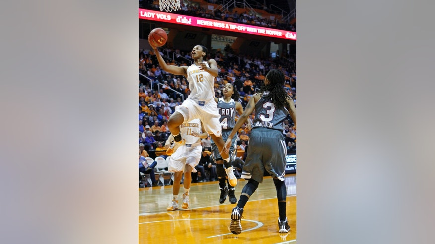 Tennessee forward Bashaara Graves (12) puts up a shot between Troy guard Ashley Beverly-Kelley (4) and Joanna Harden (3) in the first half of an NCAA college basketball game on Saturday, Dec. 14, 2013, in Knoxville, Tenn. (AP Photo/Wade Payne)