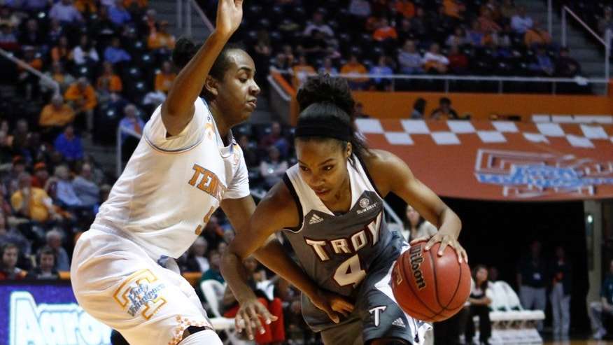 Troy guard Ashley Beverly-Kelley (4) drives against Tennessee guard Ariel Massengale (5) in the first half of an NCAA college basketball game on Saturday, Dec. 14, 2013, in Knoxville, Tenn. (AP Photo/Wade Payne)